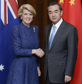 Chinese Foreign Minister Wang Yi(R) shakes hands with visiting Australian Foreign Minister Julie Bishop in Beijing, capital of China, Dec. 6, 2013. (Xinhua/Wang Ye)