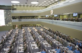 s and computer terminals are crammed into the enormous space, filling up the room with analysts working tirelessly on three separate floors as they monitor activities in the conflict zone